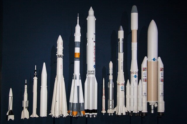 A photo composite of variousspace rockets lined up against a dark background.
